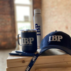 Installed Building Products hat, mug, water bottle, and lanyard